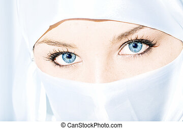 Veiled - Blue eyed girl wearing face veil