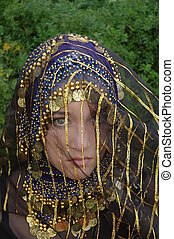 Veiled Innocence - A innocent looking girl wearing a blue...