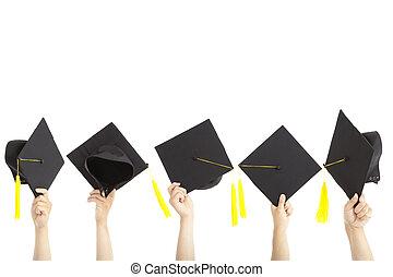 velen, hoedjes, vrijstaand, afgestudeerd, hand houdend, witte