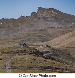 A picture of the Veleta Summit and the Virgen de las Nieves memorial, in the Sierra Nevada mountain (Spain).