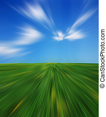 Velocity - Abstract motion with a green grass landscape and ...