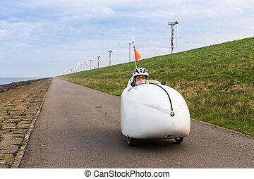 Velomobile bicycle along Dutch coast