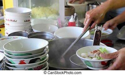 Vendor Cooking Noodle in Soup - Hawker Vendor Cooking Noodle...