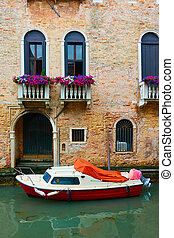 Venetian canal with motorboat - Venetian canal with moored ...