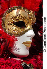 Close up on golden and red mask with feathers at the 2014 venetian carnival of Annecy, France