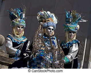 Three blue people at the 2014 Annecy venetian carnival, France