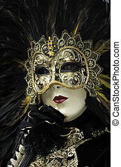 A portrait of one of the most beautiful masks photographed in open street during venetian carnival.