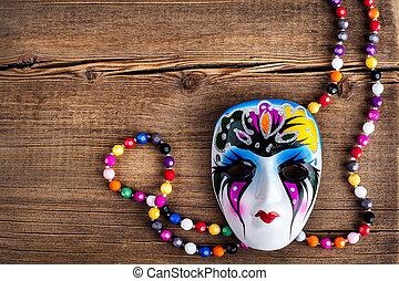 Venetian carnival mask on wooden background