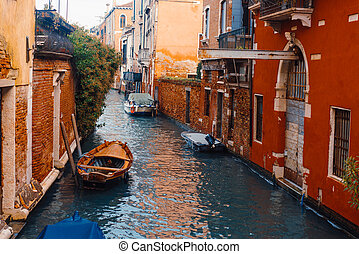 Venetian channel with ancient houses and boats