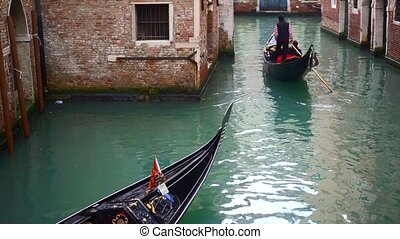 Venetian channel with ancient houses and boats, italy