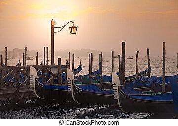 Venetian gondolas at sunrise in venice