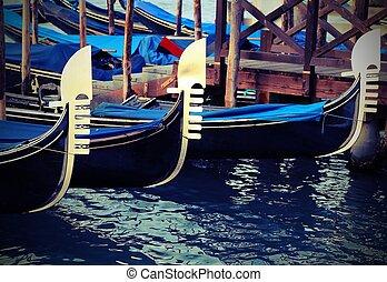 Venetian gondolas moored in landing passengers with vintage effect