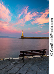 Venetian harbour and lighthouse in old harbour of Chania at sunrise, Crete, Greece. Old venetian lighthouse in Chania, Greece. Lighthouse of the old Venetian port in Chania, Greece.