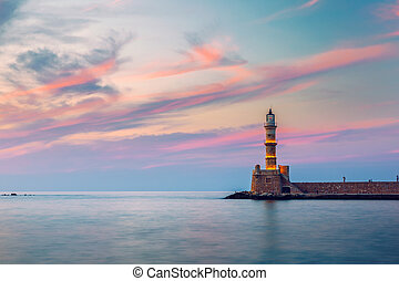 Venetian harbour and lighthouse in old harbour of Chania at sunset, Crete, Greece. Old venetian lighthouse in Chania, Greece. Lighthouse of the old Venetian port in Chania, Greece.