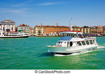 Venetian Lagoon and the white big cutter, Venice, Italy