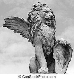 venetian lion sculpture isolated on sky, Asolo, Veneto,...