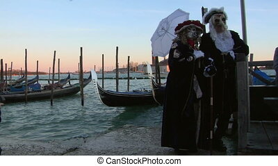 venetian mask 01 - Person in Venetian costume attends the...