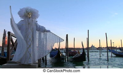 venetian mask 11 - Person in Venetian costume attends the...