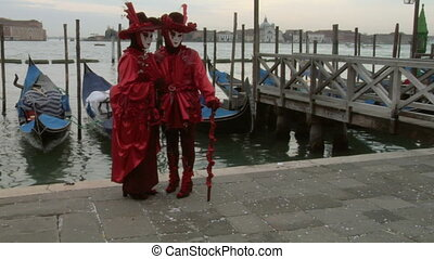 venetian mask 62 - Person in Venetian costume attends the...