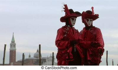 venetian mask 63 - Person in Venetian costume attends the...