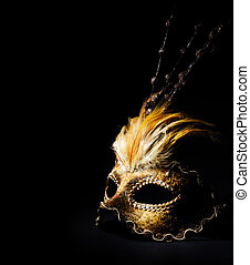 Venetian Mask - Golden venetian mask over black background
