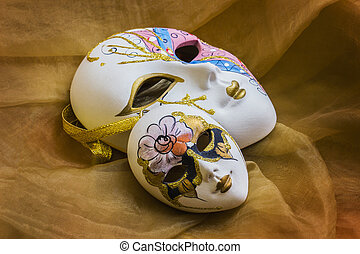 Venetian mask on the background of draping