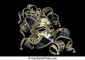 Venetian mask - Ornate venetian mask lying on black...