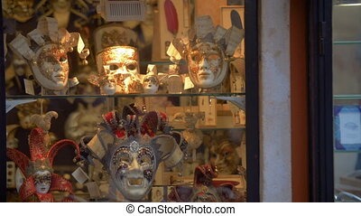 Venetian masks in glass show-window - VENICE, ITALY -...