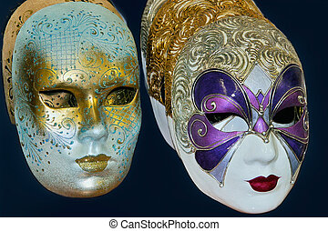 Venetian masks on display in a shop in Venice Italy