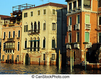 venetian palaces on the Grand canal at high tide in venice italy