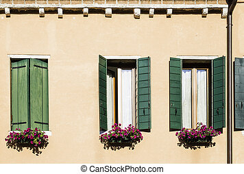 Venetian windows with flowers