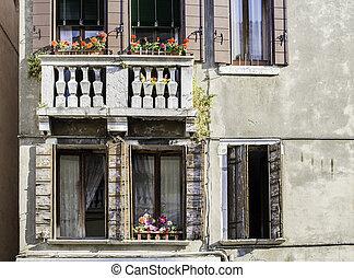 Venetian windows with flowers