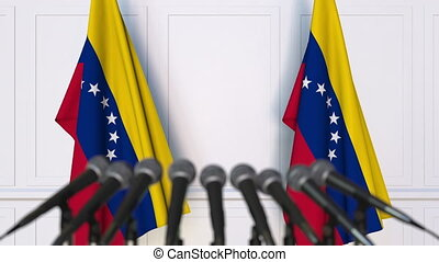 Venezuelan official press conference with flags of...