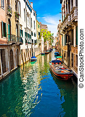 Venice canal - blue and green water of a venetian canal,...