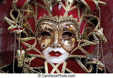 A close up portrait of a woman wearing a mask at the Venice Carnival in Italy.