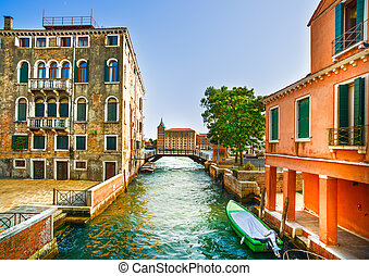 Venice cityscape, boats, water canal, bridge and old traditional buildings. Italy, Europe.