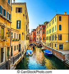 Venice cityscape, buildings, boats, water canal and double bridge. Italy