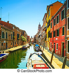 Venice cityscape, Campo San Barnaba water canal, campanile church on background, building and boats. Long Exposure photography. Italy, Europe.