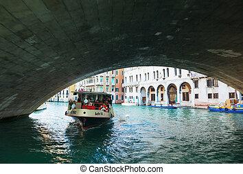 Vaporetto with tourists under Rialto Bridge (Ponte Di...