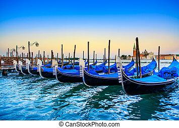 Venice, gondolas or gondole on sunset and church on ...