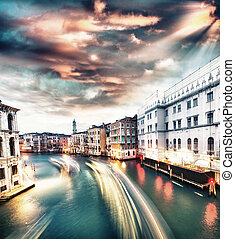 Venice. Grand Canal at sunset with Gondole and cityscape