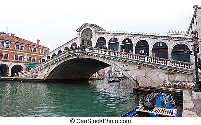 Venice Grand canal with gondolas and Rialto Bridge