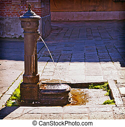 Venice, Italy - ancient iron fountain