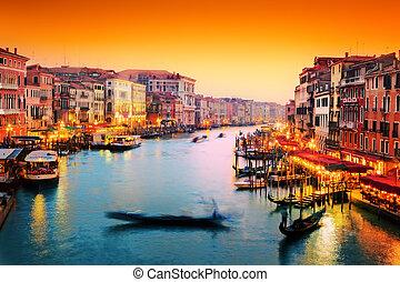 Venice, Italy. Gondola floats on Grand Canal at sunset -...