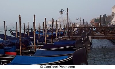 Venice, Italy. Gondolas and beautiful lamppost in the...