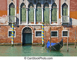 Venice, Italy - House on Grand Canal with gondola