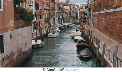 VENICE, ITALY, SEPTEMBER 7, 2017: Water Canal of Venice, Italy. Narrow Streets of Venice. Water transportation gondola boats Architecture buildings of Italy