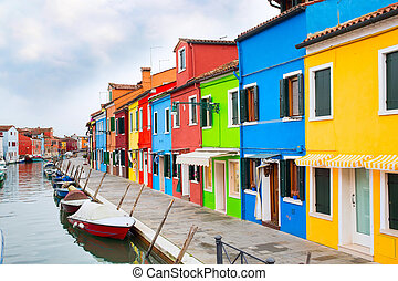 Venice landmark, Burano island, Italy, colorful houses and boats