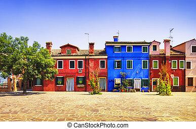 Venice landmark, Burano island square, tree and colorful houses, Italy