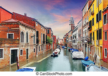 Venice landmark, canal, colorful houses and boats, Italy